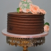 horizontal-textured-chocolate-frosting-baby-shower-cake-gold-peach-flowers