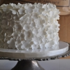 single-tier-cake-covered-with-tiny-white-flowers-2-sweet-cheeks-baking-co-kitchen