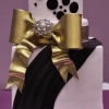 black-white-gold-bow-cake