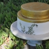 gold-painted-cake-with-painted-herbs-short-top-tier