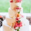 gorgeous-wedding-cake-with-draped-buttercream-pearls-painted-roses-and-flower-cascade-true-photography