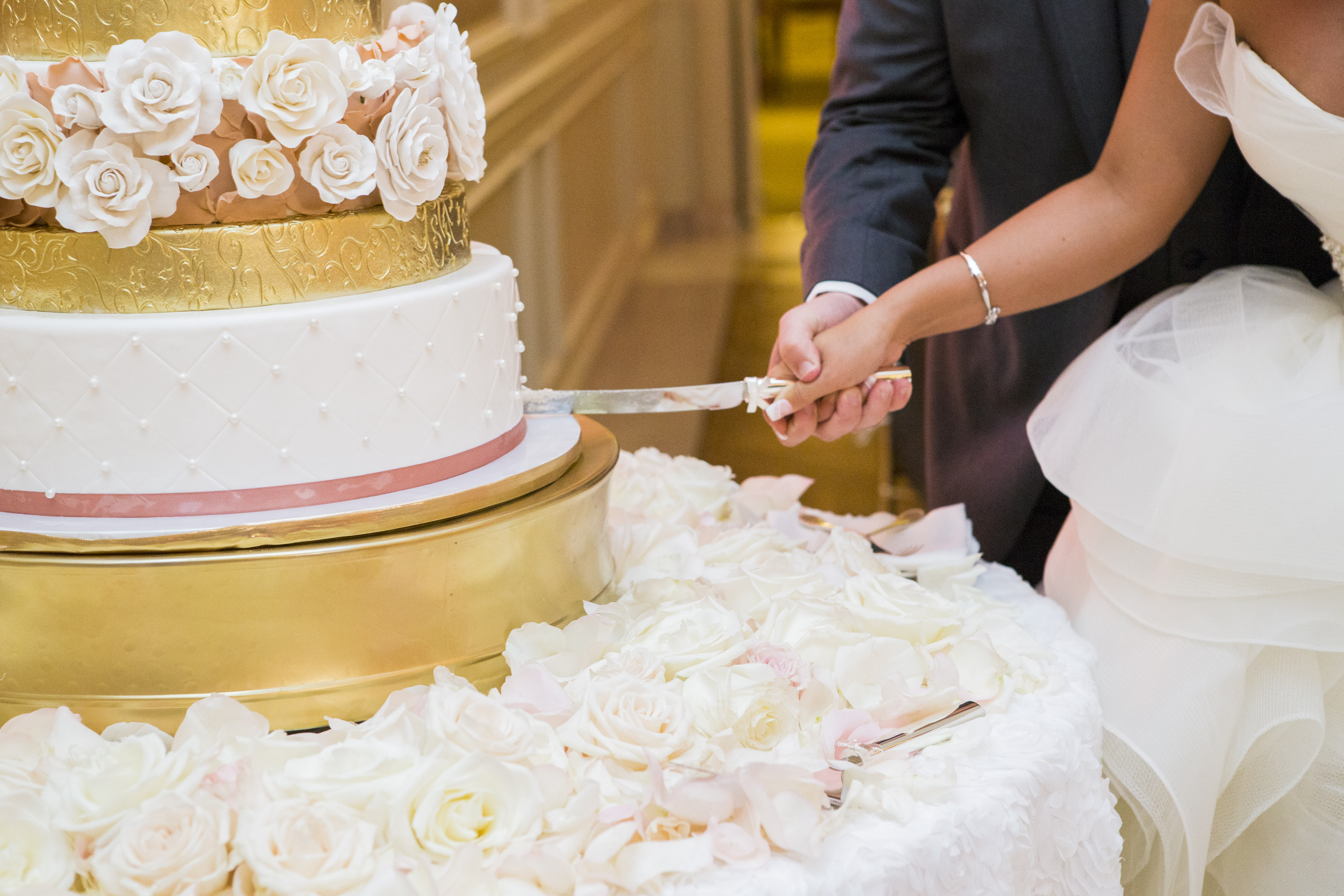 bac-cake-cutting-closeup-of-gold-painted-tiers