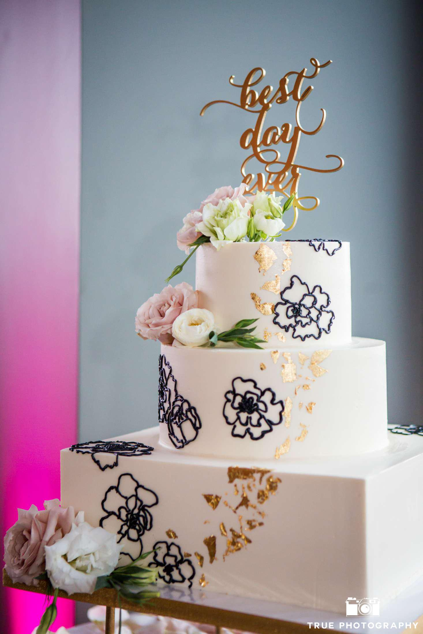black-painted-flowers-gold-leaf-wedding-cake-for-samantha_daniel-sweet-cheeks-at-ultimate-skybox-true-photography