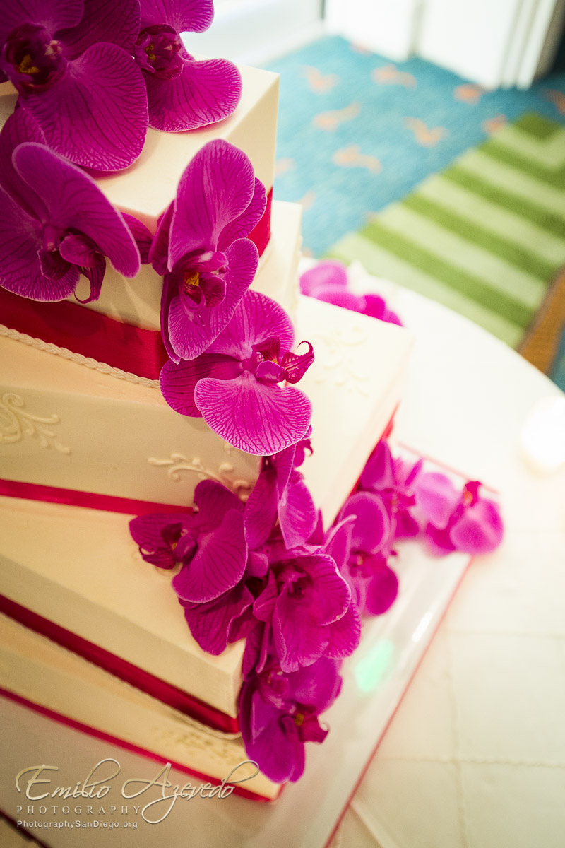 mike-heather-paradise-pt-graduated-offset-square-wedding-cake-hot-pink-ribbon-orchids