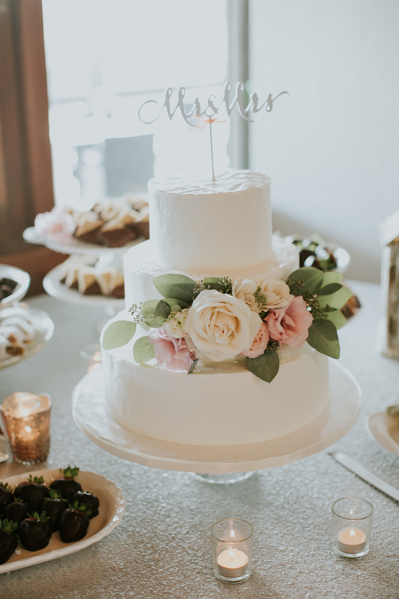 Lovely Spray Of Fresh Flowers On A Beautiful Wedding Cake